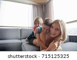 happy mother with kids having... | Shutterstock . vector #715125325