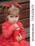 Little Girl With Cup Of Popcor...