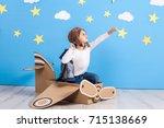 little child girl in a pilot's...   Shutterstock . vector #715138669