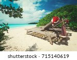 christmas on beach  chair... | Shutterstock . vector #715140619