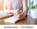 business woman hand working at... | Shutterstock . vector #715140664