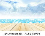 wood table top on blur... | Shutterstock . vector #715145995