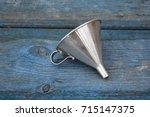 vintage metal funnel with...   Shutterstock . vector #715147375