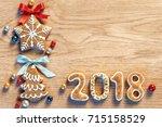 gingerbread cookies on wooden...   Shutterstock . vector #715158529