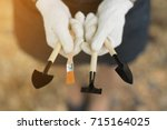 close up hands of young woman... | Shutterstock . vector #715164025