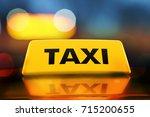 3d rendering yellow taxi sign... | Shutterstock . vector #715200655
