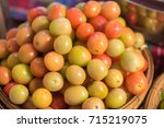 fresh red tomatoes in market | Shutterstock . vector #715219075