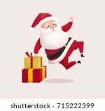 santa claus jumping. christmas... | Shutterstock .eps vector #715222399