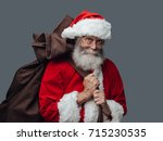 Smiling Santa Claus Carrying A...