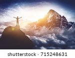 a triumphant  silhouetted... | Shutterstock . vector #715248631
