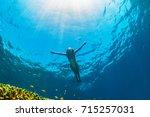 happy family   girl dive... | Shutterstock . vector #715257031