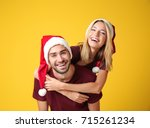 Happy Young Couple In Santa...