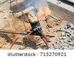 welding copper ground wire on... | Shutterstock . vector #715270921