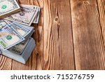 money isolated on a wooden... | Shutterstock . vector #715276759