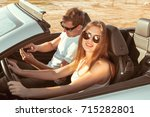 young couple traveling by car | Shutterstock . vector #715282801