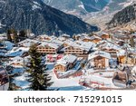 alpine village in winter | Shutterstock . vector #715291015