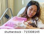 breastfeeding newborn in...   Shutterstock . vector #715308145
