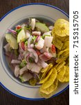 chilled spicy ceviche with... | Shutterstock . vector #715315705