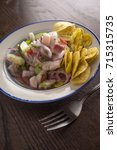 chilled spicy ceviche with... | Shutterstock . vector #715315735