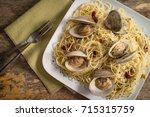 spaghetti with fresh cooked... | Shutterstock . vector #715315759