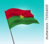 waving burkina faso flag.... | Shutterstock .eps vector #715316035