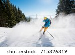 skier skiing downhill in the... | Shutterstock . vector #715326319