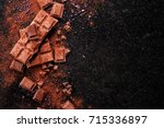 broken chocolate pieces and... | Shutterstock . vector #715336897