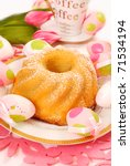 lemon ring cake with icing sugar on easter table - stock photo