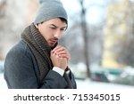 trendy fashion man on winter... | Shutterstock . vector #715345015