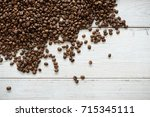 coffee beans on white wood... | Shutterstock . vector #715345111