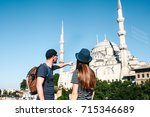a couple of tourists a young... | Shutterstock . vector #715346689