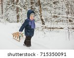 Little Girl Carries Sledge On ...