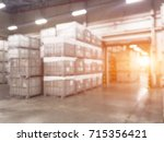 blurred warehouse or storehouse ... | Shutterstock . vector #715356421
