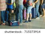 people in que waiting for check ... | Shutterstock . vector #715373914