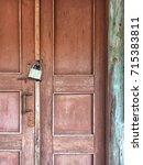 old wooden door with a lock | Shutterstock . vector #715383811