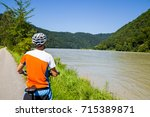 young man cycling with his... | Shutterstock . vector #715389871
