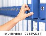 businesswoman binders female... | Shutterstock . vector #715392157
