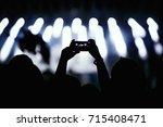 video recording of the concert... | Shutterstock . vector #715408471