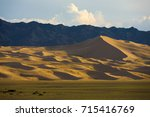 distant camels seen at the base ... | Shutterstock . vector #715416769
