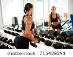 sexy fitness woman with perfect ... | Shutterstock . vector #715428391