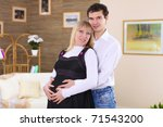 young pregnant wife and her... | Shutterstock . vector #71543200