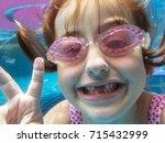 closeup of caucasian girl... | Shutterstock . vector #715432999
