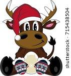cute cartoon reindeer in santa... | Shutterstock .eps vector #715438504