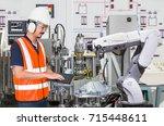 engineer using laptop computer... | Shutterstock . vector #715448611
