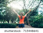 young female stretching before... | Shutterstock . vector #715448641