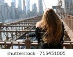 girl on brooklyn bridge | Shutterstock . vector #715451005