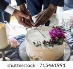 gay couple hands cutting... | Shutterstock . vector #715461991