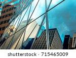 buildings reflected in windows... | Shutterstock . vector #715465009