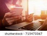online payment woman's hands... | Shutterstock . vector #715473367