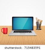 office desk with laptop | Shutterstock . vector #715483591